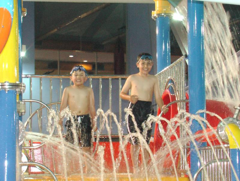 Aquatic play tower platform sprays & waterfall